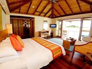 anantara veli maldives resort - over water bungalow bedroom