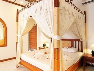 bandos island resort maldives - deluxe room
