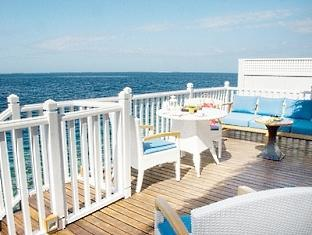 centara grand island resort maldives - deluxe family water villa terrace