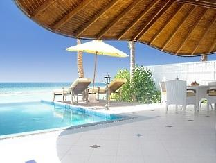 centara grand island resort maldives - two bedroom luxury beach front pool villa