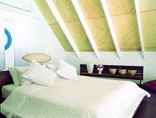 cocoa island resort maldives - dhoni loft suite bedroom