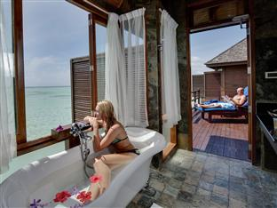 olhuveli beach spa resort maldives - -jacuzzi water villa bathroom