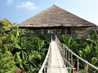 soneva fushi resort maldives - entrance to garden restaurant