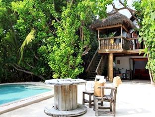 soneva fushi resort maldives - front garden of crusoe villa with pool