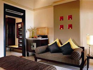 angsana resort spa ihuru maldives-deluxe beach front villa sitting area