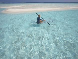 baros maldives resort - canoeing