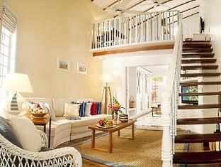 centara grand island resort maldives - beach suite livingroom
