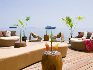 centara grand island resort maldives - reef restaurant outdoor